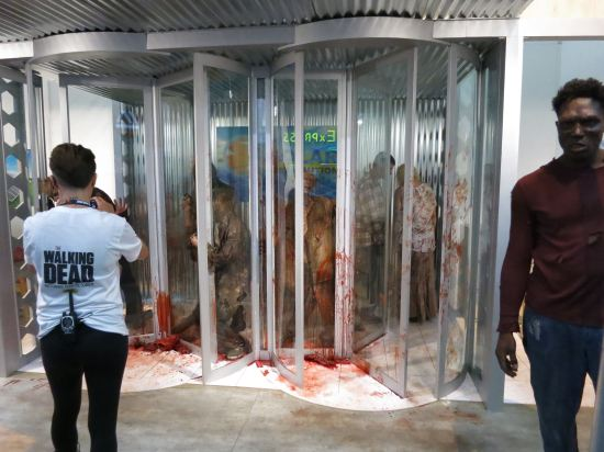 "I think The Walking Dead writers were like ""hey, what can we write into the show that would be a really cool booth at Comic-Con next year?"" Hence the revolving door scene."